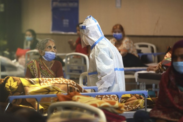 A health worker talks to a woman in a Covid-19 quarantine centre in New Delhi, on Monday. Photo: AP