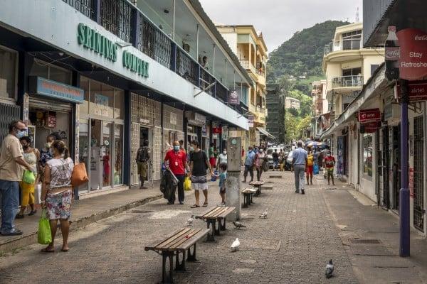 Pedestrians walk on a street in the capital Victoria, Seychelles. File photo: AP