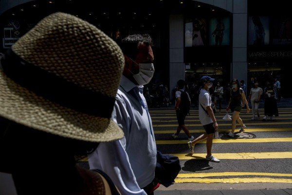People walk past a pedestrian crossing during lunch hour in the Central district of Hong Kong, on June, 7. Photo: Bloomberg
