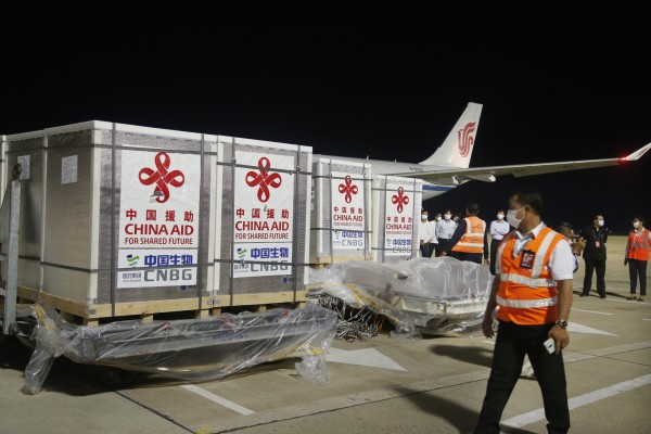 Workers unload Sinopharm Covid-19 vaccine at Phnom Penh airport in Cambodia. File photo: Xinhua