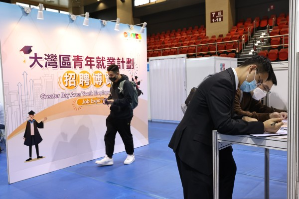 People attend an an online job fair under the Greater Bay Area Youth Employment Scheme. About 20 organisations set up booths and conducted on-the-spot recruitment at MacPherson Stadium in Mong Kok on March 23. Photo: K.Y. Cheng