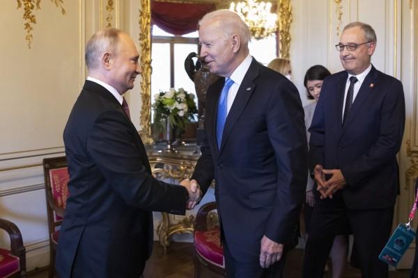 Russian President Vladimir Putin and  US President Joe Biden shake hands in Geneva on Wednesday. Photo: EPA-EFE