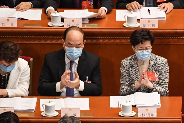 Macau Chief Executive Ho Iat-seng (centre) and Hong Kong Chief Executive Carrie Lam (right) attend the opening session of the National People's Congress in Beijing on May 22, 2020. Photo: AFP