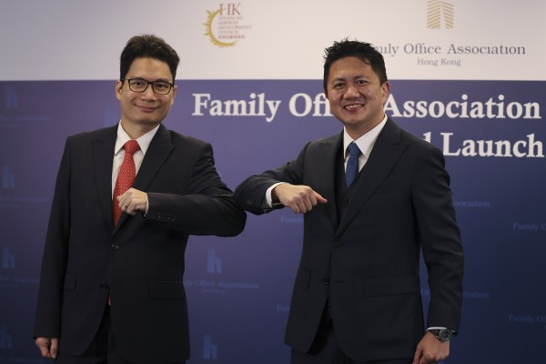 Joseph Chan Ho-lim, undersecretary for Financial services and the Treasury (left), and Kwan Chi-man, chairman of the Family Office Association Hong Kong, attend the association's opening ceremony at the InvestHK office in Admiralty on November 18, 2020. Photo: Nora Tam