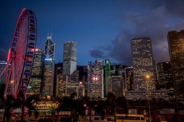 Buildings housing major banks stand illuminated at dusk in Hong Kong's Central district on July 25, 2019. Photo: Bloomberg