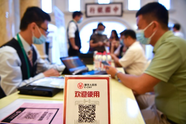 A man signs up to pay with the e-yuan, China's digital currency, at an expo in Hainan on May 8. Photo: Xinhua