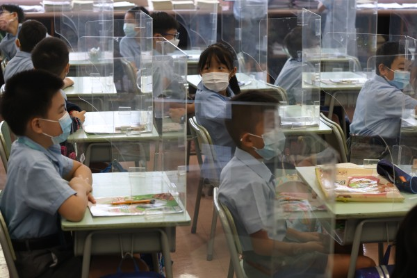A primary school in Hong Kong resumes half-day sessions. Since under-12s aren't eligible for vaccination yet, full-day sessions for kindergarten and primary school pupils remain off the table for now, more than a year into the Covid-19 pandemic. Photo: K.Y. Cheng