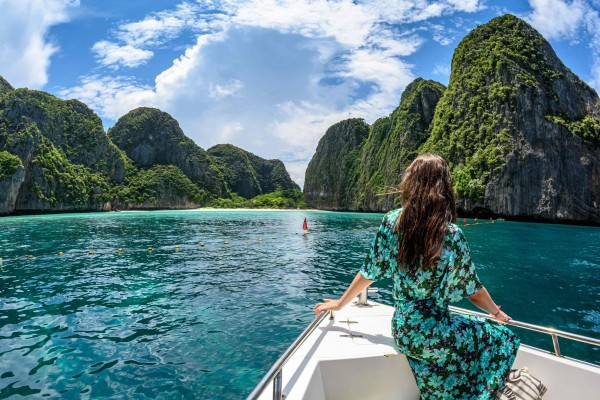A tourist on a boat on the southern Thai island of Koh Phi Phi in 2019. Photo: AFP