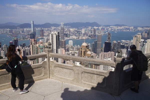 A visitor takes a look at the Hong Kong skyline from The Peak. Photo: Winson Wong