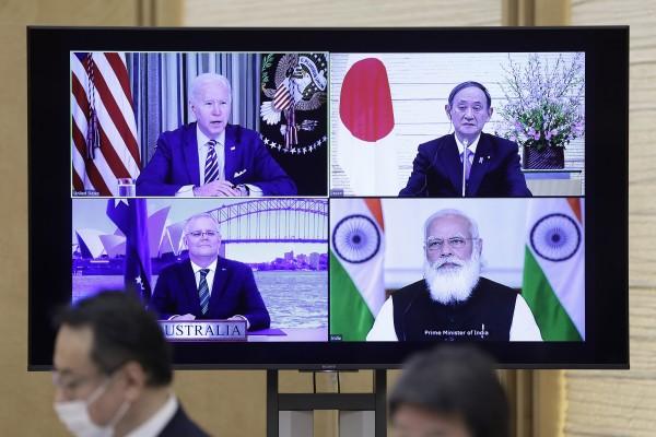 A monitor in Tokyo displays the virtual 'Quad' meeting of (clockwise from top left) US President Joe Biden, Japan's Prime Minister Yoshihide Suga, India's Prime Minister Narendra Modi and Australia's Prime Minister Scott Morrison. Photo: Bloomberg
