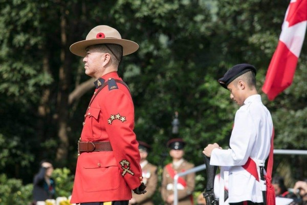 Ben Chang, who was the Royal Canadian Mounted Police liaison officer in Hong Kong, attends a commemorative ceremony at the Sai Wan War Cemetery in December 2017. Photo: SCMP/Global Affairs Canada