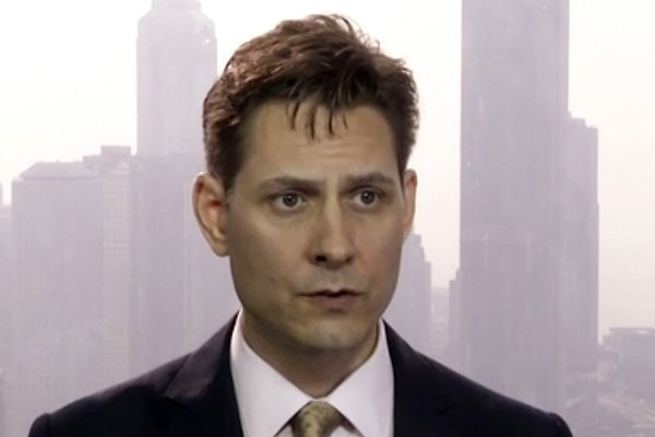 The trial of Michael Kovrig, pictured in 2018, began in Beijing on Monday. The Canadian government says Kovrig and fellow Canadian Michael Spavor, were arrested in 2019 in apparent retaliation for Canada's detention of a senior Huawei executive. (AP Photo/File)