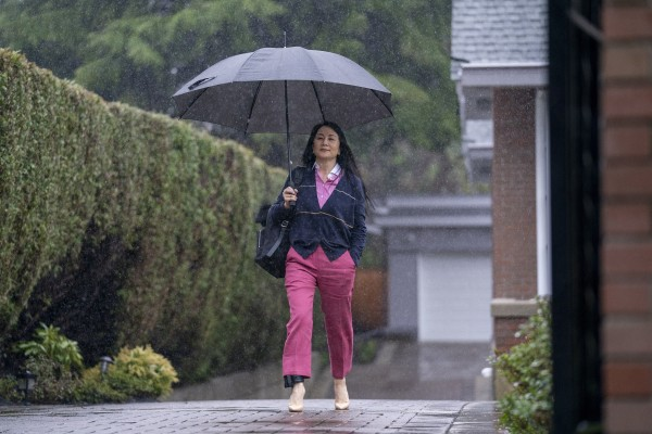 Meng Wanzhou, Huawei Technologies' chief financial officer, leaves her home in Vancouver on Wednesday to attend an extradition hearing. Photo: The Canadian Press via AP