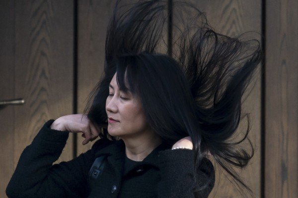 Meng Wanzhou's hair is caught in a gust of wind as she leaves her home in Vancouver to attend her hearing at the Supreme Court of British Columbia on Thursday. Photo: AP