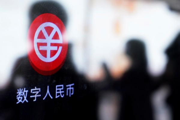 A sign indicating digital yuan, also referred to as e-renminbi, is pictured on a vending machine at a subway station in Shanghai on April 21. Photo: Reuters
