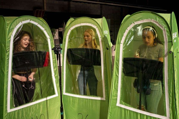 Students record vocals in pop-up tents during choir class at Wenatchee High School in Wenatchee, Washington. File photo: AFP