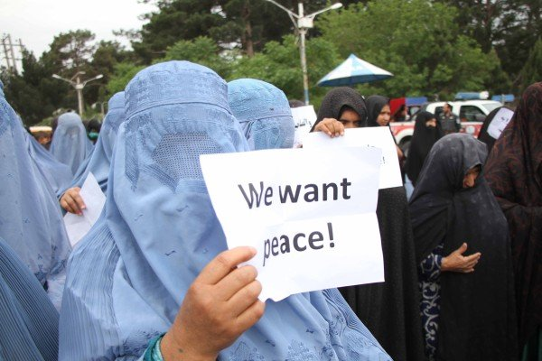 Afghan people hold posters calling for peace during a protest on Sunday in Herat to condemn violence, which has surged in Afghanistan since a missed May 1 deadline for US troops to withdraw. Photo: EPA