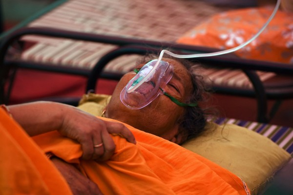 A patient breathes with the help of oxygen in Ghaziabad, India. Photo: AFP/Getty Images