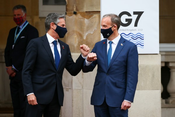 Dominic Raab, right, welcomes Antony Blinken to the G7 meeting in London. Photo: Bloomberg