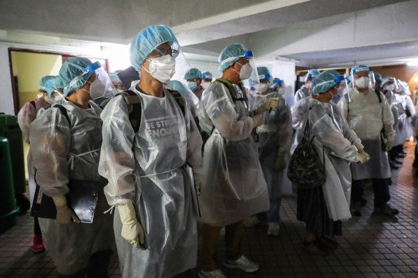 Medical workers in protective gear arrive at a Hong Kong housing block subject to a mandatory testing order. Photo: Edmond So