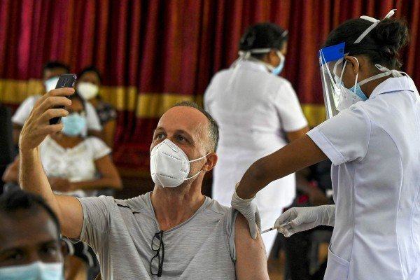 A health worker inoculates a man with a dose of the Sputnik V Covid-19 vaccine in Colombo, Sri Lanka. Photo: AFP