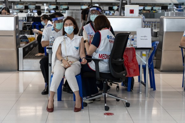 An airport employee gets vaccinated against Covid-19 in Bangkok. Photo: Bloomberg