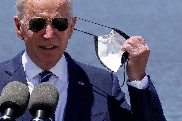 US President Joe Biden removes his face mask to speak at an event in Lake Charles, Louisiana, on Thursday. Photo: Reuters