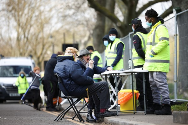 People swab themselves for Covid-19 at a testing site in London. File photo: Reuters