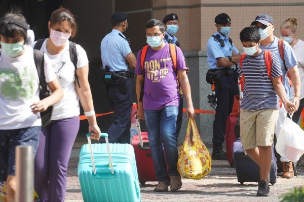 Residents are evacuated from a Tung Chung housing block after a resident was found to be carrying a mutated coronavirus variant. Photo: Winson Wong