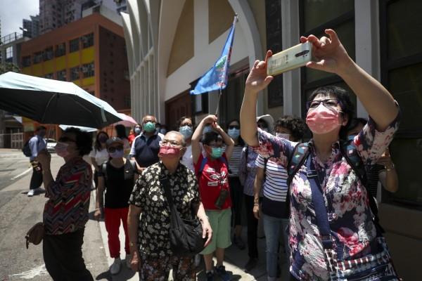 A local tour group explores Sheung Wan on Saturday. Photo: Xiaomei Chen