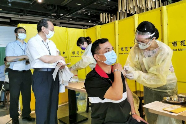 Taoyuan airport employees receive Covid-19 vaccination. Photo: CNA