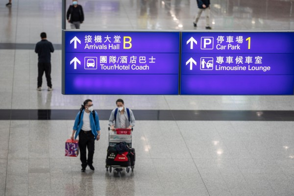 Passengers walk through the arrival hall at Hong Kong International Airport in April. Photo: EPA-EFE