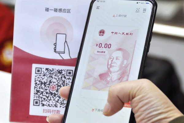 A group of major financial institutions have set up e-wallets on the digital yuan app developed by the People's Bank of China. Photo: Kyodo