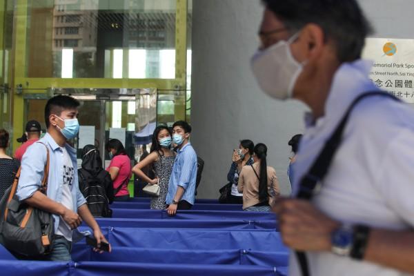 People queue up for BioNTech vaccine shots at Sun Yat Sen Memorial Park Sports Centre in Sai Ying Pun. Photo: Xiaomei Chen