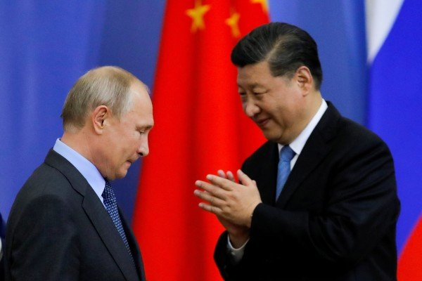 Chinese President Xi Jinping with his Russian counterpart Vladimir Putin in St. Petersburg. File photo: Reuters