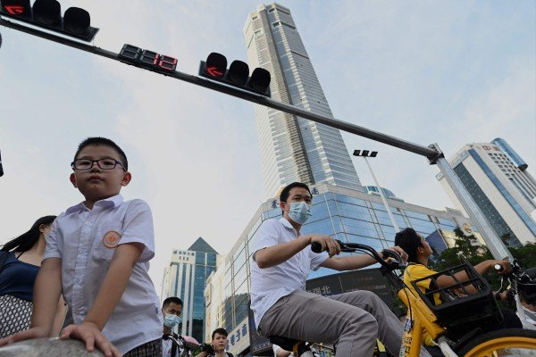 People go past the temporarily closed 300-metre SEG Plaza in the southern Chinese city of Shenzhen on May 24. Photo: AFP