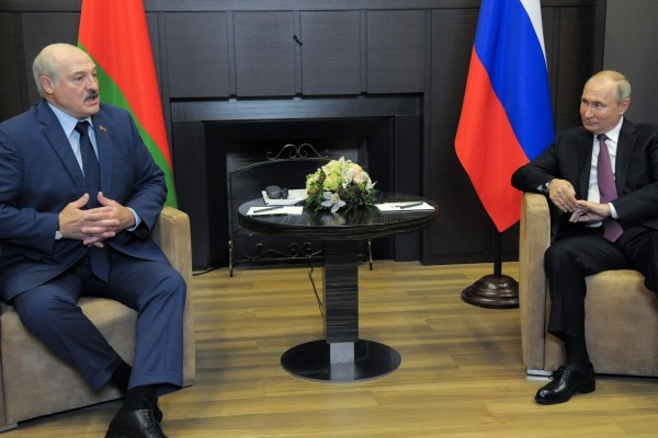 Russian President Vladimir Putin (right) listens to Belarusian President Alexander Lukashenko during their meeting in the Black Sea resort of Sochi on Friday. Photo: AP