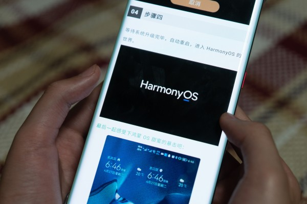 A Huawei Technologies Co smartphone user reads news about the HarmonyOS 2.0 beta test in Shanghai on May 5, 2021. Photo: Barcroft Media via Getty Images