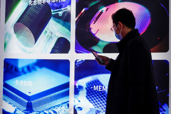 A man visits a display of semiconductor devices at Semicon China, a Shanghai trade fair for semiconductor technology, in March. Photo: Reuters