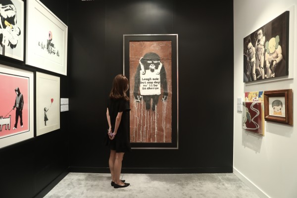 Banksy's 'Laugh Now Panel A' painting, which is estimated at US$4.1 million at the top end, is displayed at JW Marriott Hotel, in Admiralty, ahead of its auction on Tuesday. Photo: Jonathan Wong