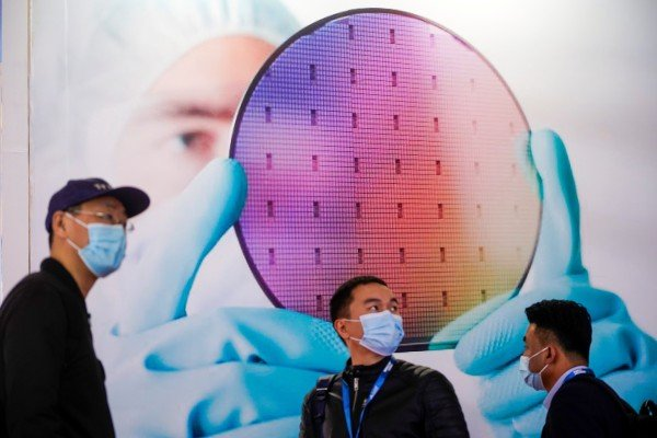 People visit a display of a semiconductor device at the Semicon China trade fair in Shanghai on March 17. The number of new chip-related companies in China rose threefold in the period January to May compared with the same period in 2020. Photo: Reuters