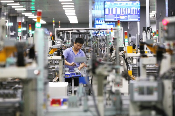 The economy of manufacturing powerhouse Guangdong expanded by 13 per cent in the first half of this year, with a nearly 27 per cent increase in exports despite port delays in May. Photo: Xinhua