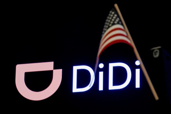 An American flag is seen in front of the logo for Chinese ride hailing company Didi during the initial public offering on the New York Stock Exchange floor in June. Photo: Reuters