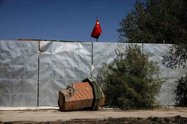 A broken-off minaret from the Xinqu Mosque lies near a Chinese national flag in Changji outside Urumqi, in China's Xinjiang Uygur autonomous region, in May. Photo: Reuters