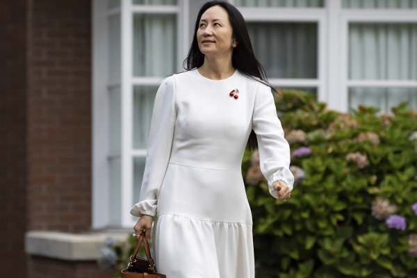Meng Wanzhou, chief financial officer of Huawei Technologies Co., leaves her home in Vancouver to attend her extradition hearing on Tuesday. Photo: The Canadian Press via AP