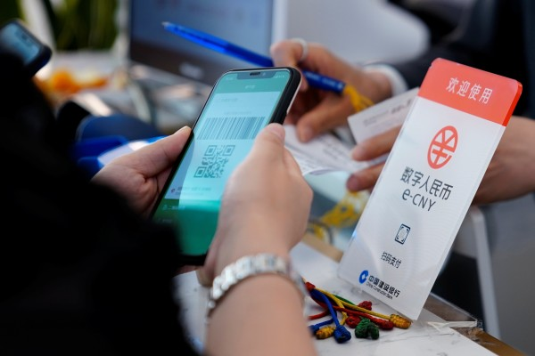 The digital yuan – developed by the central bank and now under trial in a dozen cities – adopts a two-tier structure, where the central bank issues the digital currency to authorised commercial banks, which then exchanges and circulates it to the public. Photo: Reuters