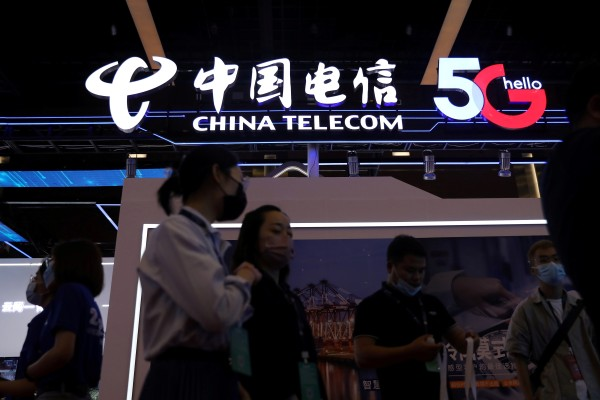 People are seen at a China Telecom booth during the 2021 China Internet Conference in Beijing in July. Photo: Reuters