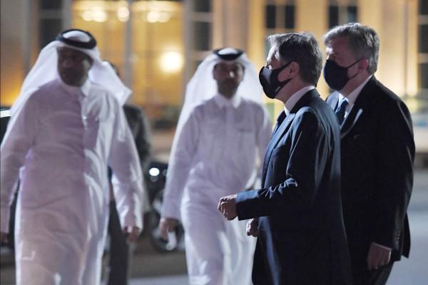 US Secretary of State Antony Blinken, second right, walks alongside US Ambassador John Desrocher upon arrival at Old Doha Airport in Qatar's capital on Monday. Photo: AFP