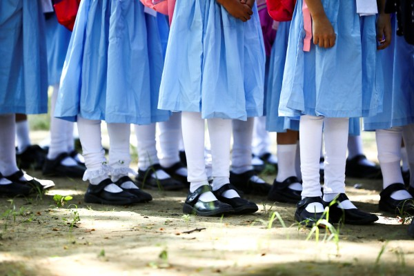 Pupils queue outside a school in Dhaka after classrooms reopened in Bangladesh on Sunday after nearly one and a half years of closure. Photo: Reuters