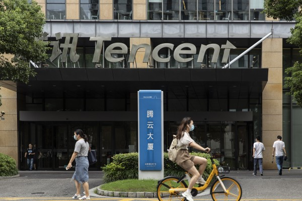 Pedestrians walk past Tencent's office in Shanghai, China, on August 16, 2021. Photo: Bloomberg